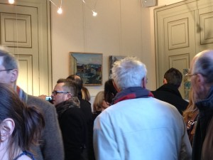 My painting in the corner.  This room was very crowded, which may also have to do with the champagne being served...